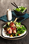 Feta skewers with bacon and lamb's lettuce