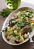 Spicy chicken with limes and a herb sauce