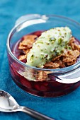 Cherry soup with cereal flakes and pistachio ice cream