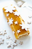 Mango & banana sponge roll with star-shaped biscuits for Christmas