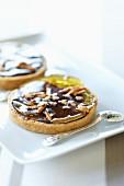 Mini chocolate tart with caramelised pears