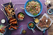 Assorted barbecued dishes with salad accompaniments