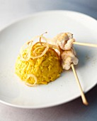 Curry-infused rice with chicken skewers
