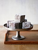 Lamingtons coated in grated coconut