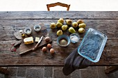 Ingredients for pear clafoutis on a wooden table