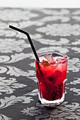 Caipirinha with blackberries and basil