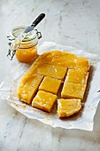 Tray bake sponge topped with lemon jelly, cut into squares