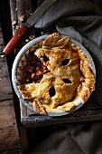 An autumnal pumpkin and apple pie