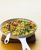 Sauteed corn, bacon and scallions