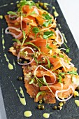 Gravad lax with citrus marinade, onions and capers