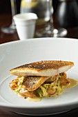 Fried sea bass fillets on ribbon pasta with mussels