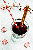 Mulled wine with a cinnamon stick and a drinking straw