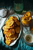 Potato crisps with a carrot and coriander dip