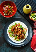 Grilled chicken skewers with salsa and avocado (Mexico)