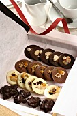 Chocolate cookies with nuts in a present box