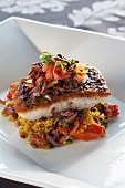 Fried barramundi fillet on saffron quinoa