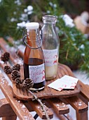 Two glass bottles of Nutella dip and vanilla sauce on a wooden board