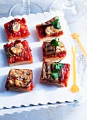 Tray-baked pizza squares with tomatoes, aubergines and garlic