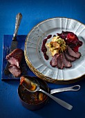 Duck fillet with a boozy plum sauce and chickpea purée