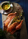 Flame-grilled chicken with orange stuffing and a mango & coconut sauce