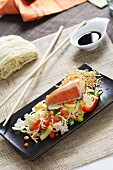 Pasta with vegetables and salmon fillet, soy sauce (Asia)
