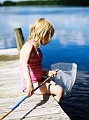 Little girl with fishing net