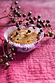 A muffin with elderberry jam in the mixture