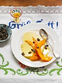 Vanilla ice cream with sweet pumpkin in orange and vanilla syrup