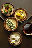 Sticky rice and mango rolls, nori sushi, mango sushi and tofu skin sushi