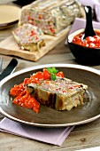 Meatloaf wrapped in aubergine, with tomato sauce