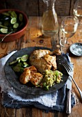Chicken leg with potatoes, courgette and couscous