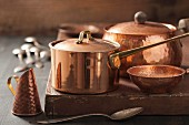 Assorted copper pots and cooking utensils