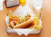 A Hot Dog with the Works and French Fries in a Metal Basket