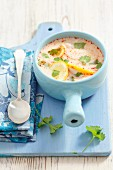 Chicken and lemon soup with coriander leaves