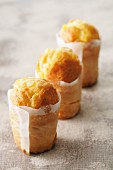 Sweet mini cakes wrapped in grease-proof paper