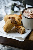 Deep-fried chocolate bars and a mug of cocoa