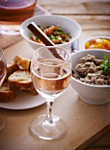 Sardine mousse with bread and rosé wine