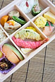 Bento box with fish, tempura, vegetables etc. (Japan)