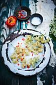 Deep-fried elderflowers on a table in the garden