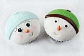 Two fun cupcakes with snowman faces