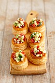Vol au vents with avocado and tomato salad