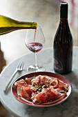 Parma ham with capers and red wine
