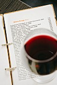 A glass of red wine on a wine list