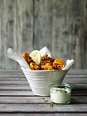Deep-fried squash with lemon and a yoghurt dip