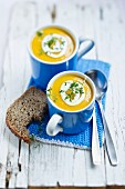 Carrot soup with sour cream and cress
