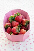 Fresh strawberries in a paper bowl