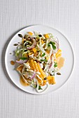 Cabbage and sweetcorn salad with raisins and pumpkin seeds