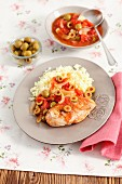 Chicken breast with green olives, onions, tomatoes and rice