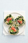 Spaghetti nests with spinach and prosciutto