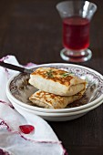 Stuffed Crepes with a Dill Garnish